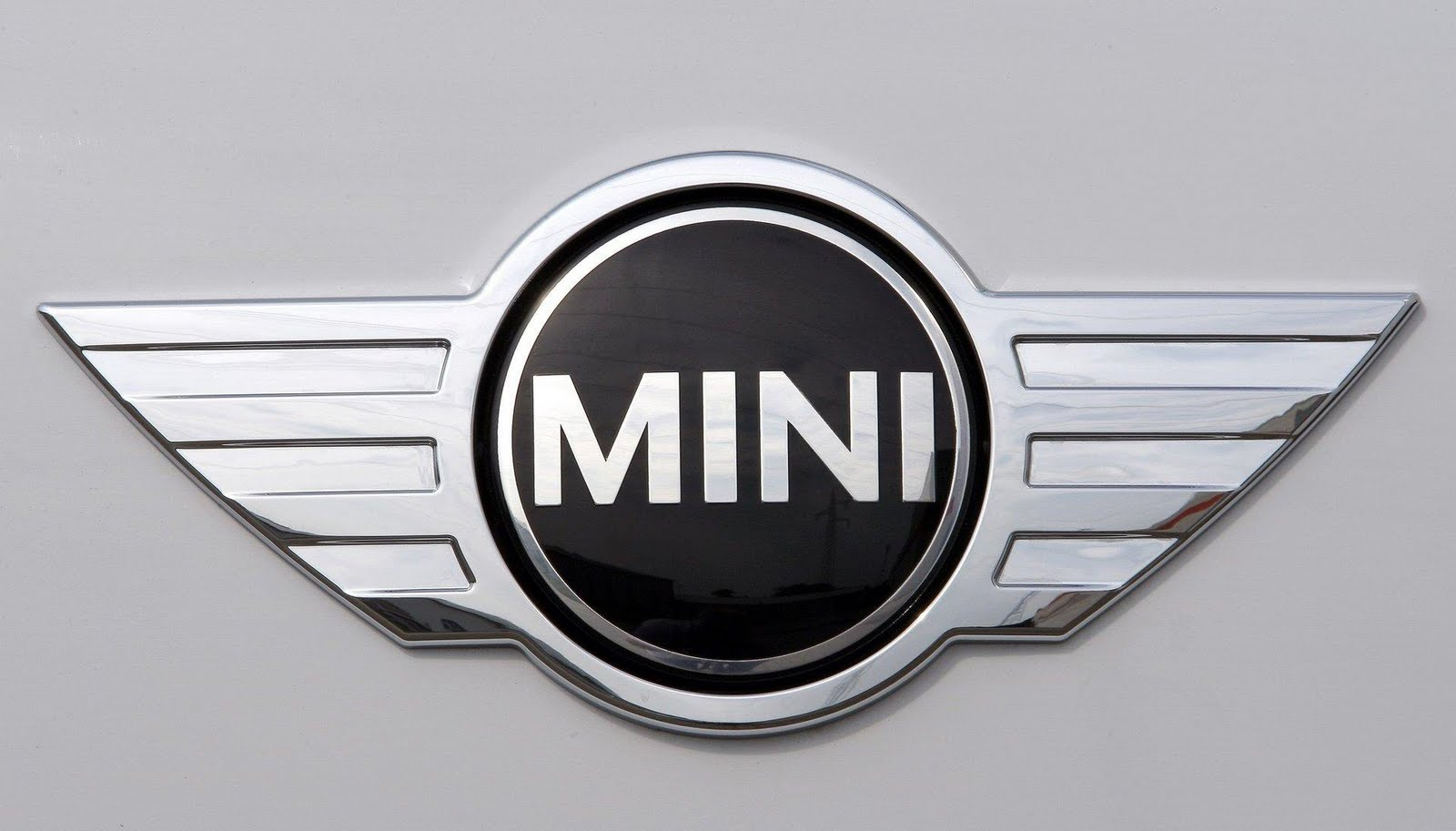 Mini Cooper Logo Mini Car Symbol Meaning And History Car Brand Names Com